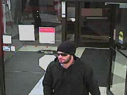 man, seen here leaving a bank in High River, Friday in Grand Prairie Man Leaving Home