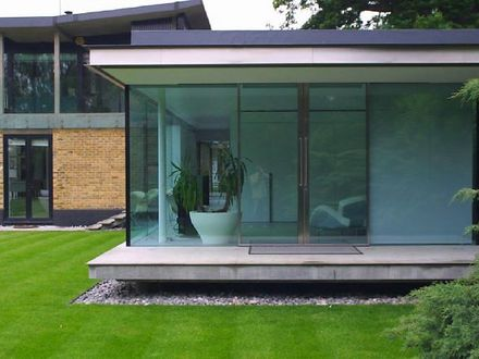 Houses with Lots of Open and Glass Houses Close Together