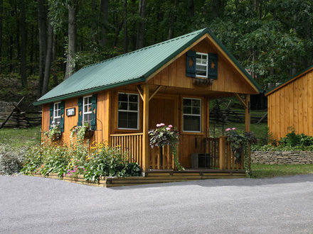 Small log cabin porches log home front porch small for Small camping cabin kits