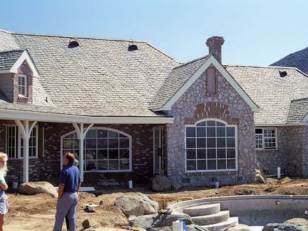 Luxury log cabin home plans most expensive log homes for Log and brick home