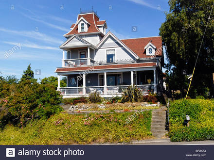 Stock Photo historic Victorian house with mansard gable & decorative Historic Victorian Landscaping
