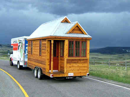 """Square Feet Conversion Chart The 130 square foot """"Fencl"""" tiny house being pulled by a small truck"""