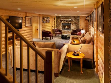 basement family room with a rustic cabin look, made with pine half Family Game Room in Basement