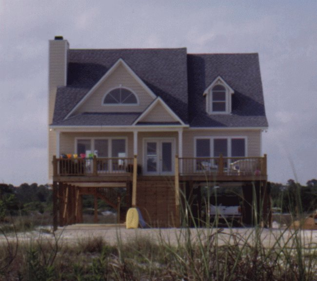Small beach house plans beach house plans with porches for Elevated house plans on pilings