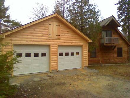 Log cabin with attached garage log cabin with garage log for Apartment homes with attached garage