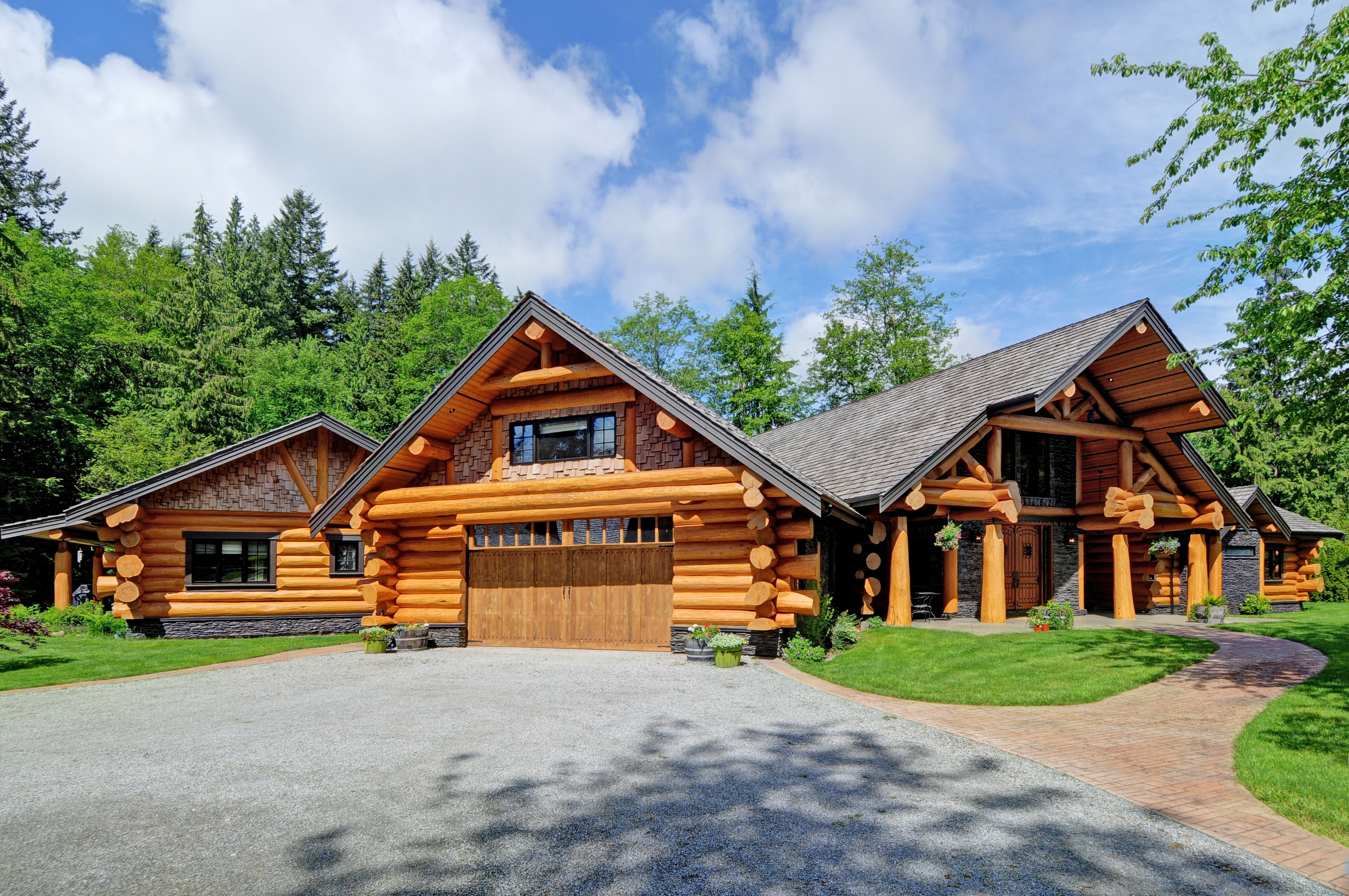Handcrafted log home summit and timber homes square