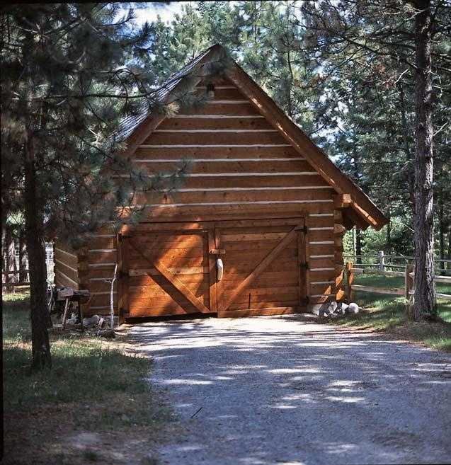 Big log cabin homes log cabin homes with garage log cabin for Log cabin floor plans with garage